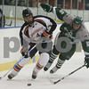 Salem: Salem State senior Brett Noll, left, carries the puck past Plymouth State freshman Josh Reagan during the second period of their team's game at Rockett Arena in Salem on Thursday. Photo by Matthew Viglianti/Staff Photographer Thursday, November 19, 2009.