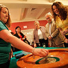 "Salem: Brynn Thompson of salem works the roulette wheel at the ""You Oughta be in Pictures"" fundraiser for North Shore Elder Services in Salem on Thursday. Photo by Matthew Viglianti/Staff Photographer Thursday, April 29, 2010."