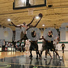 Beverly: Gerard Coleman from the Tilton School in New Hampshire, (24), hangs for a reverse-layup as Ledrick Eackles from the Hargrave Military Academy (12), leaps to defend the shot during the second half of the National Prep School boys basketball championship game between Tilton and Hargrave at Endicott College in Beverly on Tuesday. Coleman finished with 25 points to help Tilton win the game 97-93. Photo by Matthew Viglianti/Staff Photographer Tuesday, March 10, 2009.