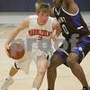 Lawrence: Marblehead senior Eric Steen, left, drives against Belmont senior Montezuma Goodwin during the second half of their teams' Division 2 North boys basketball semifinal state tournament game in Lawrence on Thursday evening. Belmont senior captain Anthony Paolillo broke a 52-52 tie with a free throw to give Belmont a 53-52 lead, and eventually the win, with five seconds left in the game. Photo by Matthew Viglianti/Salem News Thursday, March 05, 2009