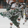 Salem: ian Flanagan, a Salem State sophomore (14), lays a big hit on Plymouth State sophomore Chris Johnson during the first period of Salem State's game against Plymouth State at Rockett Arena in Salem on Thursday. Photo by Matthew Viglianti/Staff Photographer Thursday, November 19, 2009.