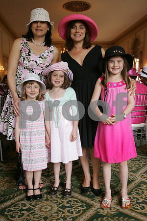 Salem: From left to right, Jennider Pratt and her daughter Lizzie Pratt, 5, from Marblehead, pose for a photograph with Sophia Marston, 7, her mother Sarah Marston, and sister Anna Marston, 9, from Swampscott, at the 5th annual Pink Tea gathering in Salem on Sunday. The event raises money for the Hospice of the North Shore. Photo by Matthew Viglianti/Staff Photographer Sunday, May 3, 2009.