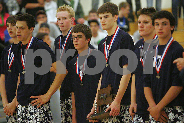 Ashland: St. John's Prep senior Patrick Heffernan, center right, holds the runner up trophy as he and his teammates watch Lincoln-Sudbury receive the state  championship trophy following their championship match in Ashland on Thursday. Lincoln-Sudbury won the match three games to zero. Photo by Matthew Viglianti/Staff Photographer Wednesday, June 11, 2009.