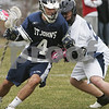 Peabody: Garrett Campbell from St. John's Prep protects the ball while under defensive pressure from Peabody's Anthony Panopoulos during their teams' game in Peabody on Wednesday. The Prep won the game 17-4. Photo by Matthew Viglianti/Staff Photographer Wednesday, April 1, 2009.