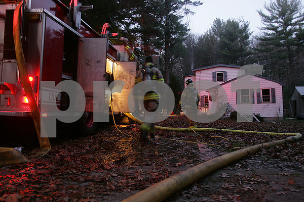 Ipswich: Firefighters work the scene of a house fire at 357 Linebrook Road in Ipswich on Monday afternoon. Photo by Matthew Viglianti/Staff Photographer Monday, November 17, 2008.