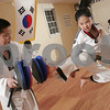 Danvers: Lina Hong practices a flying kick as her father, Master Soon Woo Hong holds padded targets during Tae Kwon Do practice at the Tigers Tae Kwon Do Academy on Maple Street in Danvers on Tuesday. Lina Hong is part of the demonstration team at the Academy. Photo by Matt Viglianti/Salem News Tuesday, October 21, 2008