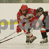 Byfield: Masconomet junior Meghan Twomey, left, carries the puck past Beverly forward Janelle Parker, a Danvers native, during the second period of the Chieftains first round playoff game against Beverly in Byfield on Monday. Masco won the game 4-1 to advance to the next round. Photo by Matthew Viglianti/Staff Photographer Monday, February 23, 2009.