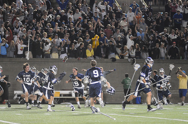 Cambridge: The St. John's Prep bench explodes in celebration after senior James Fahey scored the winning goal in sudden death overtime of the Division 1 state championship game between St. John's Prep and Duxbury at Harvard Stadium in Cambridge on Wednesday night. Photo by Matthew Viglianti/Staff Photographer Wednesday, June 16, 2010.