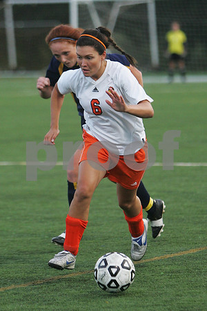 Salem: Salem State junior Amber Warnick pushes the ball upfield for the Vikings during their home game against UMass Dartmouth in Salem on Tuesday. Photo by Matt Viglianti/Salem News Tuesday, September 16, 2008
