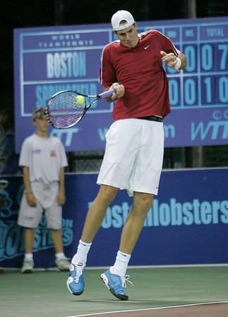 Middleton: John Isner, who is currently ranked No. 19 in the world, returns a shot while playing with the Boston Lobsters of World Team Tennis in a doubles match against Martin Damm and Rik De Voest of the Springfield Lasers at the Sheraton Ferncroft in Middleton on Tuesday night. Isner, who won the longest tennis match in history at Wimbledon this year, paired with teammate Eric Butorac for the match. Photo by Matthew Viglianti/Staff Photographer Tuesday, July 13, 2010.