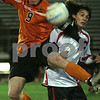 Salem: Beverly senior captain Ethan Trowt, left, leaps into a challenge against Salem sophomore Brion Likaj during the first half of the Panther's away game against Salem on Thursday evening. Salem won the game 2-1. Photo by Matthew Viglianti/Staff Photographer Thursday, October 29, 2009.