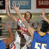 Salem: Salem junior Bryan Ortiz skies for a shot attempt over Easton Boston defenders Andre Seniors, left, and Kevin Orenella, right, during the second half of their state tournament game in Salem on Wednesday. Salem lost the game 66-58. Photo by Matt Viglianti/Salem News Wednesday, February 25, 2009