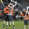 Marblehead: The Beverly Panthers celebrate a fourth period goal by senior Jack Liacos (16) during their game in Marblehead on Wednesday. The goal put the Panthers up 7-5 with just under 7 minutes left in the game. They would go on to win 8-6 to take sole possession of the Northeastern Conference championship. Marblehead would have earned a share of the title with a win. Photo by Matthew Viglianti/Staff Photographer Wednesday, May 26, 2010.