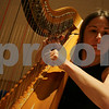 Salem: Emily Lewis of Salem tunes her harp before performing with the Salem Philharmonic Orchestra at Salem High School on Sunday afternoon. Photo by Matthew Viglianti/Staff Photographer Sunday, February 15, 2009.