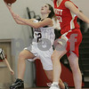 Marblehead: Marblehead sophomore Ariana Freddo goes up for a layup, but has her shot blocked by Everett's Lisa Award during the second quarter of the Magician's home game against Everett on Monday. Photo by Matt Viglianti/Salem News Monday, December 15, 2008