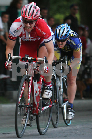 Salem: Sally Annis from Nashua, NH, in red, leads Kathryne Carr of East Hampton, MA in the final stretch of the women's race during the Witches Cup in Salem on Wednesday. Annis finished first in the race, with Carr finishing a close second. Photo by Matt Viglianti/Salem News Wednesday, August 13, 2008