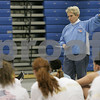 Peabody: Jane Heil, head coach of the Peabody girls basketball team, talks to a group of girls at try-outs on Wednesday. Photo by Matt Viglianti/Salem News Wednesday, December 03, 2008