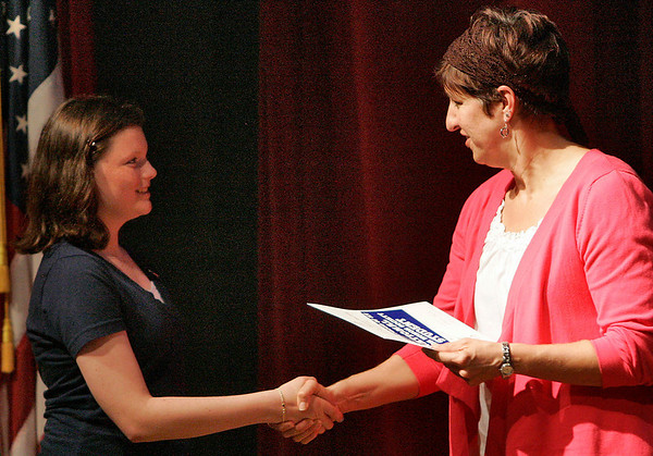 Salem: Paige Cole, left, receives a handshake and certificate from Lisa Golden after being inducted into the National Junior Honor Society on Wednesday night at Collins Middle School. Induction recognizes a committment to scholarship, leadership, character, service, and citizenship, in each of the eigth grade students qualified for the Society. Golden serves as administrator for Forrester Wharf. Photo by Matthew Viglianti/Staff Photographer Thursday, June 3, 2010.