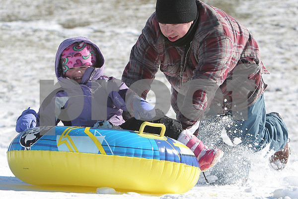 Peabody: Aaron Rozansky of Peabody pushes his daughter, Morgan, 3, up the hill after a round of sledding behind the Higgins Middle School in Peabody on Sunday. Photo by Matthew Viglianti/Staff Photographer Sunday, January 4, 2009.