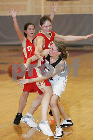 Marblehead: Marblehead junior Bridgett Forbes, right, sneaks a pass around Everett defenders Spressa Ramadani, left, and Lisa Award, center, during the second quarter of Marblehead's home game against Everett on Monday night. Photo by Matt Viglianti/Salem News Monday, December 15, 2008