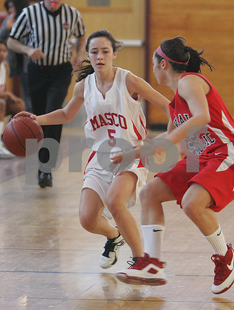 Topsfield: Courtney Allison, a sophomore on the Masconomet basketball team, left, dribbles the ball up-court while under pressure from Central Catholic's Ashley Evangelista during the first half of their teams' game in Topsfield on Sunday. Photo by Matthew Viglianti/Staff Photographer Sunday, February 1, 2009.