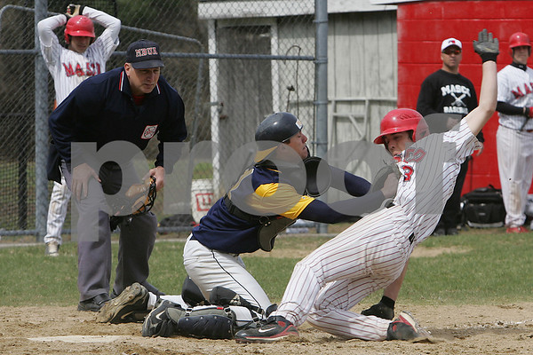 Topsfield: Dan Gusovsky from Andover tags out Masconomet's Gabe Dunn at home during the third inning of Masco's home game against Andover in Topsfield on Monday. Photo by Matthew Viglianti/Staff Photographer Monday, April 20, 2009.