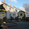 Peabody: Dennis Kolodziej from the Peabody Fire Department surveys the scene of a fire on Warren Street in Peabody on Tuesday afternoon. Photo by Matthew Viglianti/Staff Photographer Tuesday, February 17, 2009.