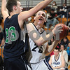 Wenham: Gordon College freshman David Dempsey, right, makes a move to the basket against Endicott College sophomore Matt Bibeau during the second half of their teams' game in Wenham on Thursday. Photo by Matthew Viglianti/Staff Photographer Thursday, December 3, 2009.