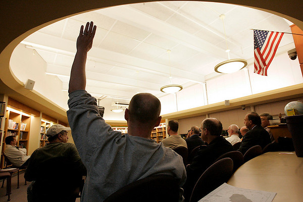 Middleton: Paul Crofts of Middleton raises his hand to make a point in opposition to plans to designate an adult entertainment zone on land off Route 114 during a public hearing held by the Planning Board on Wednesday night. Crofts argued that businesses located near the designated zone are being asked to assume more and unfair risks compared to other town businesses. Photo by Matthew Viglianti/Staff Photographer Wednesday, April 14, 2010.