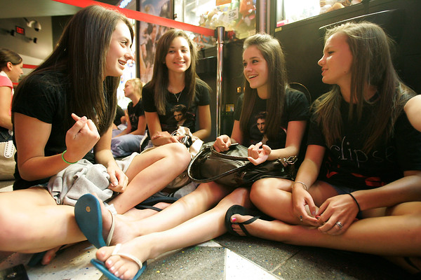 Twilight fans wait to enter theaters to see Eclipse, the newest movie in the series.