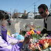 Peabody: Carlos Ceaser from Peabody stops to buy flowers from Hiroko Izumi on his way to his sister's house in Peabody for Easter on Sunday afternoon. Photo by Matthew Viglianti/Staff Photographer Sunday, April 12, 2009.