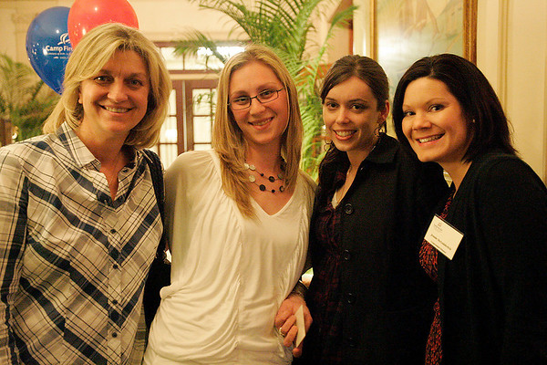 Salem: From left, Joanne Connor from Lynn, Lindsay Amoroso from Peabody, Heather Bourgeois from Peabody, and Jennie McGoldrick from Salem, at the 100th anniversary kickoff for Camp Fire in Salem on Thursday. Camp Fire hosts after school programs, clubs, and summer camps for local children. Photo by Matthew Viglianti/Staff Photographer Thursday, March 25, 2010.