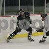 Hamilton: Jon Ahearn, left, dumps the puck into the Worcester Academy zone as Neil Baldwin, right, moves in to defend the play during the first period of the Highlanders 2-1 loss to Worcester Academy in Hamilton on Wednesday. Photo by Matt Viglianti/Salem News Wednesday, December 10, 2008