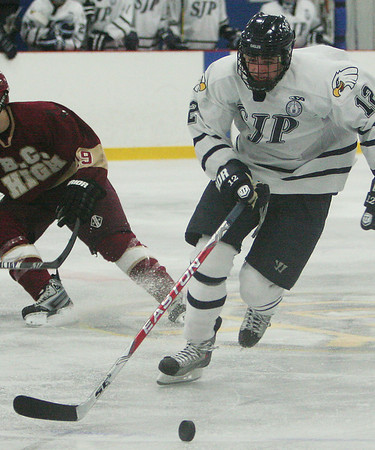 Wilmington: Devin Murray, a junior for St. John's Prep, carries the puck up-ice for the Eagles during their game against BC High in Wilmington on Saturday. The Prep won the game 3-2. Photo by Matthew Viglianti/Staff Photographer Saturday, January 23, 2010.
