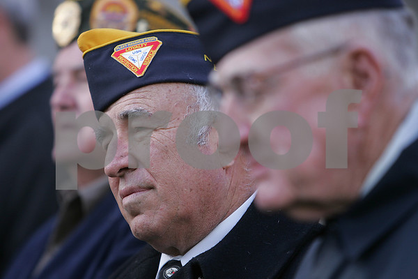 Peabody: Peabody Municpal Light Comissioner Tom Paras listens during a Veterans Day ceremony outside Peabody City Hall on Tuesday morning. Photo by Matt Viglianti/Salem News Tuesday, November 11, 2008