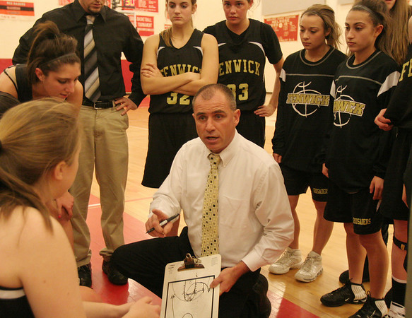 Melrose: Bishop Fenwick head coach Tim Harrington speaks with his team prior to the start of the fourth period of their Division 3 North semifinal game against Stoneham in Melrose on Wednesday. Fenwick won the game 53-49 to advance to the next round of the state tournament. Photo by Matthew Viglianti/Staff Photographer Wednesday, March 3, 2010.
