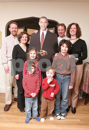 Salem: From left to right, David Buckhoff, Holly Grose, Jonah Barz-Snell, 3, Leah Barz-Snell, 7, Oliver Buckhoff, 3, Jeff Barnz-Snell, Jacob Barz-Snell, 9, and Jennifer Barnz-Snell, pose with a lifesized cut-out of President-Elect Barack Obama at the Barnz-Snell home in Salem on Wednesday. The Friends of Forest River Park are holding an inagural ball on Saturday to raise money for a new playground, and plan to bring the cut-out to the party for guests to pose with. Photo by Matthew Viglianti/Staff Photographer Wednesday, January 14, 2009.