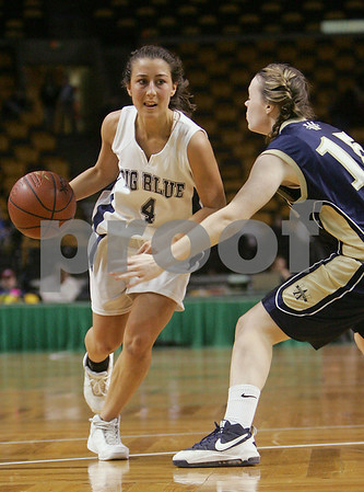 Boston: Swampscott senior Marissa Gambale surveys the defense for options while being guarded by Colleen Downing from Archbishop Williams during the state semifinals at the TD Banknorth Garden in Boston on Monday. Photo by Matt Viglianti/Salem News Wednesday, March 11, 2009