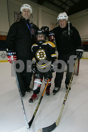Salem: Three generations of the Garfield family from Marblehead are involved in Marblehead Mites hockey. From left to right are Scott Garfield, head coach of the Marblehead Mites 1 team, his son, Jacob, 8, and Scott's father, Jerry, another coach for the team. Photo by Matt Viglianti/Salem News Sunday, January 18, 2009