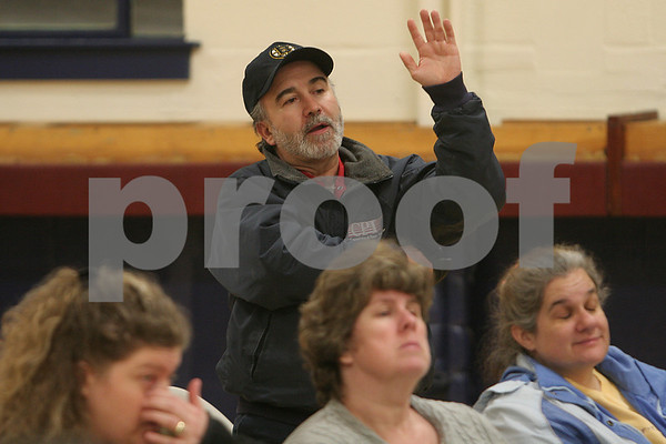 Peabody: Ray Lajoie from Salem raises a point during a meeting at St. Thomas Church in Peabody to brainstorm ways to save St. Joseph's School in Salem from closing on Wednesday night. Three generations of Lajoie's family, including he and his daughter, attended St. Joseph's School, and he hopes that it can remain open for future generations. The Archdiocese, which owns the school, announced its closing this month. Photo by Matt Viglianti/Salem News Wednesday, January 21, 2009