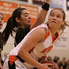Ipswich: Ipswich junior Hannah O'Flynn, right, eyes the basket against Bishop Fenwick junior Erin Botticelli during the second half of Ipswich's home game against Fenwick in the Division 3 North quarterfinal on Thursday. O'Flynn had 21 points for the Tigers, but they fell short to Fenwick 75-53. Photo by Matthew Viglianti/Staff Photographer Thursday, February 25, 2010.