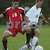 Beverly: XXXX Lazarek from Beverly, right, shields the ball from Marblehead captain Nick Belesis during the second half of their game in Beverly on Monday. Photo by Matt Viglianti/Salem News Monday, October 13, 2008