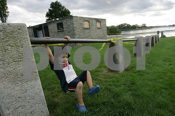 Beverly: Daniel Pratt, 3, from Beverly, swings on the fencing at Obear Park in Beverly while playing with his father Harry and brother Nicholas, 7, on Monday afternoon. Photo by Matt Viglianti/Salem News Monday, September 15, 2008