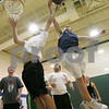 Beverly: Ethan Trowt, 17, from Beverly, right, leaps to block a shot attempt by George Gomes, 18, from Beverly, during a pick-up basketball game at the Sterling Center YMCA in Beverly on Monday afternoon. Photo by Matt Viglianti/Salem News Monday, February 23, 2009