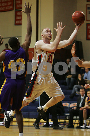 Salem: Salem State senior captain Dylan Holmes eyes the rim as he drives for a layup during Salem State's game against Williams College for the Salem State Christmas Tournament title on Tuesday. Photo by Matthew Viglianti/Staff Photographer Tuesday, December 30, 2008.