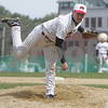 Topsfield: Evan Bunker from Masconomet follows the flight of his pitch during Masco's home game against Andover on Monday. Photo by Matthew Viglianti/Staff Photographer Monday, April 20, 2009.