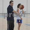 Swampscott: Swampscott girls basketball coach Jack Hughes positions his team while diagramming a play during practice on Thursday afternoon. Senior Marissa Gambale prepares to run the play from the point guard position. Photo by Matthew Viglianti/Staff Photographer Thursday, March 12, 2009.
