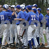 Peabody: Stephen Moran (23) steps on home plate while being surrounded by his Big Blue teammates after hitting a home run to lead off Swampscott's away game against Peabody on Wednesday. Photo by Matthew Viglianti/Staff Photographer Wednesday, May 6, 2009.