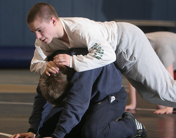 Swampscott: Josh Levy, top, practices his technique with Kristian Kotov at practice with the Marblehead/Swampscott wrestling team on Thursday. Photo by Matthew Viglianti/Staff Photographer Thursday, January 7, 2010.