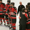Cambridge: Marblehead junior captain Jake Kulevich gets a hug from head coach Bob Jackson as the team watches Scituate celebrate winning the Division 3 state semifinal at the Bright Center at Harvard University on Wednesday night. Marblehead fell 5-2, with Kulevich scoring both of the team's goals. Photo by Matthew Viglianti/Staff Photographer Wednesday, March 10, 2010.